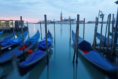 Early morning view of Venice with San Giorgio Maggiore Church in the background and gondolas parking in the Grand Canal Royalty Free Stock Image