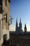 Early morning view of Zagreb cathedral. Silhouette of the Zagreb cathedral and many roofs seen from a plateau on Upper Town on early winter morning Stock Photography