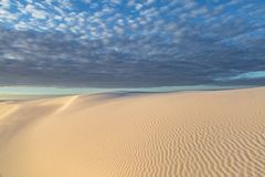 Early Morning at White Sands National Monument, New Mexico. Clouds over White Sands Desert in New Mexico, at Sunrise stock image