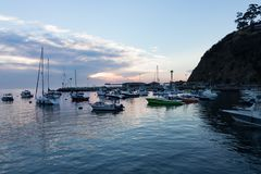 Early morning wide view of sunrise seascape, Avalon Bay, Santa Catalina Island with sailboats, yachts and fishing boats royalty free stock photography
