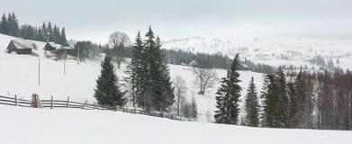 Early morning winter mountain village landscape. Early morning winter mountain village panorama landscape Jablunytsia village, Carpathian Mountains, Ukraine royalty free stock photos