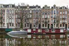 Early morning winter view on one of the Unesco world heritage ci. Ty canals (Singelgracht and Leidsegracht) of Amsterdam, The Netherlands Stock Images