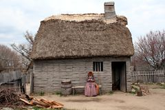Early New England Settlement Home. An early New England settlement home with thatched roof royalty free stock photos