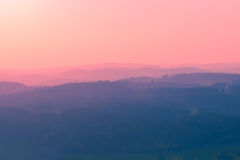 Early pink dawn in the mountains Stock Photo