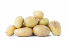 Early potatoes on a white background. Royalty Free Stock Photography