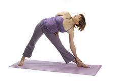Early pregnant woman doing yoga and stretching Stock Images