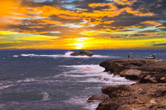 Early Risers. Fishermen up early, Laie Point, Hawaii Stock Image