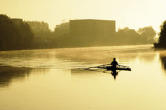 Early Rower on River Trent. Early Rower on the River Trent in Nottingham taken from below Lady Bridge in the early morning just about Sunrise Royalty Free Stock Image