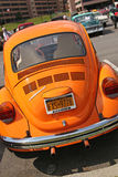 Early 1970s Beetle. Early 1970s orange Volkswagen beetle car in parking lot at VA Hospital classic car show Royalty Free Stock Photos