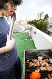 Munching Off the Grill Stock Images