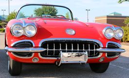 Early 1950's model red antique Corvette. 1950's model red Chevrolet corvette in pristine showroom condition Royalty Free Stock Photo