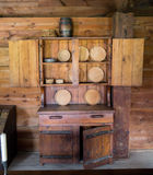 Early Settlers kitchen cabinet. Early settlers kitchen cabinet with wooden plates stock photography