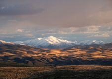 Early Snow. Snow covers a mountain peak in along I80 in Nevada while hills in foreground show the golden brown of  early fall Royalty Free Stock Image