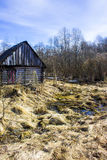 Early spring and abandoned village bath in the Creek, Northern Russia. Abandoned village bath in the Creek, Northern Russia Royalty Free Stock Photos