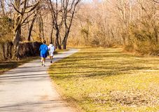 Early Spring Crosscountry Run. Two joggers out on an early March run stock images
