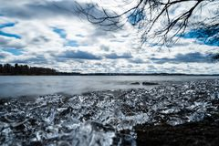 Early spring day on lakeshore Royalty Free Stock Image