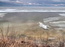 Early Spring at the Lake Cabin is still cold with some Ice on th. E Lake and dead Grass Royalty Free Stock Photography