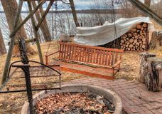 Early Spring at the Lake Cabin is still cold with some Ice on th. E Lake and dead Grass Stock Image