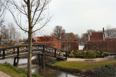 Labyrinth garden with bridge. An early spring landscape view of a labyrinth garden on the water side and with a bridge Stock Photo