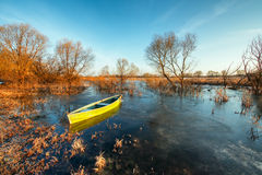 Early spring landscape with wooden boat Stock Photography