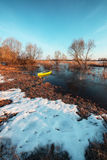 Early spring landscape with wooden boat Stock Photos