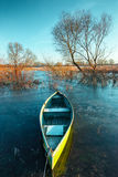 Early spring landscape with wooden boat Royalty Free Stock Photo