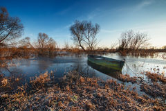 Early spring landscape with wooden boat Stock Photo