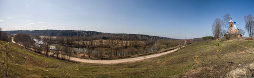 Early spring panorama. River Nara, Moscow region, Russia. Church on the hill Royalty Free Stock Photos