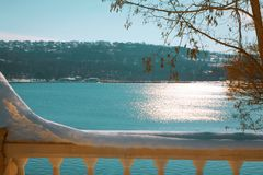 Early spring scenery with lake. Scenic view of urban lake , snow on balustrade Stock Photography