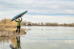 Early spring stand up paddling royalty free stock photography