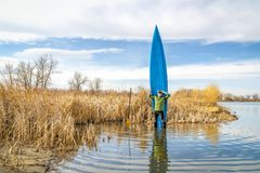 Early spring stand up paddling royalty free stock image