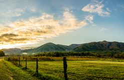 Smoky Mountain Sunrise along Sparks Lane, Cades Cove. Early Spring sun rising in Great Smoky Mountains National Park, glowing mountains background, meadow, lane royalty free stock photography