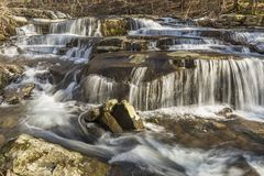 Early Spring Thaw at Stony Clove Falls. A multi-tiered waterfalls on Stony Clove Creek in Greene Country in the Catskill Mountains in Edgewood, New York Royalty Free Stock Photo