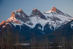 Early spring time in Canmore in Alberta, Canada. Early spring time in Canmore, snowy mountains, winter atmosphere, icy cold, symbols of town of Canmore, Canada stock photo