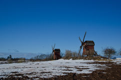 Early springtime. With melting snow and two windmills in a rural landscape Royalty Free Stock Photography