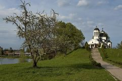 Early springtime green,  lake, bell tower and church with modern architecture in district Drujba. Sofia, Bulgaria Royalty Free Stock Photography