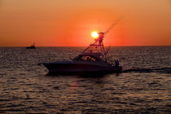 Early Start for Fishing. Sport fishing boats heading out just before sunrise for a day of fishing stock images