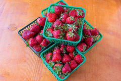 Early Strawberry in green  plastic packages Royalty Free Stock Photo