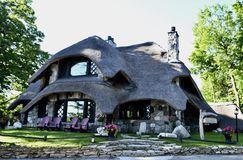 "Thatch Roof House. This is an early Summer morning picture of the iconic ""Thatch Roof House"" or ""Mushroom House located in Charlevoix, Michigan royalty free stock photo"