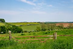 Early summer view of rolling English countryside. Early summer view across the rolling English countryside of the Lincolnshire Wolds royalty free stock photos