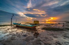 Early sunrise with single boat Royalty Free Stock Image