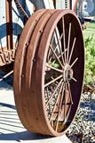 Early 20th Century Farm Machinery Wheel. A rusty steel wheel from an early 20th century farm implment shows in the sunshine Royalty Free Stock Photography