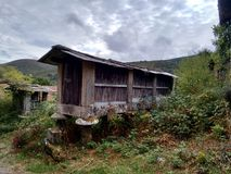 Early twentieth century elevated barn in Ourense Galicia Spain. Early twentieth century elevated barn in Ourense Galicia Spain during a cloudy day stock photography