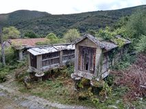 Early twentieth century elevated barns in Ourense Galicia Spain. Early twentieth century elevated barns in Ourense Galicia Spain during a cloudy day royalty free stock photos