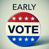 Early vote in the United States election. Closeup of a badge with the word vote written in it, and the word early, for the early vote in the United States Royalty Free Stock Photo