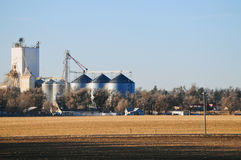 Early winter morning on rural farmland and silos Royalty Free Stock Photo