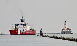 The Christmas Tree Ship. This is an early Winter picture of the iconic U.S. Coast Guard Cutter Mackinaw better known as the Christmas Tree Ship passing the royalty free stock images