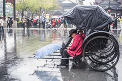 The rickshaws waiting for guests on the Confucius Temple market in the early winter and rainy days. In the early winter and rainy days, the rickshaw driver royalty free stock photos