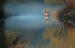 EarlyMorning Fog. Narrowboat moored in the early moring fog Stock Images