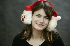 Earmuff with Santa Claus. Girl with Christmas. Earmuff with Santa Claus Stock Photo